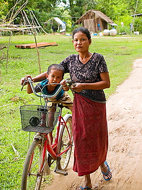 grandmother and grandson with a bicycle on Don Khon island in Laos