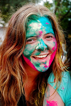 Panjim Goa, India, foreign tourist with colored powder on the face during the Holi feast - 817-193982