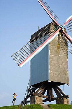 Photographer shots windmill in Brugge, Belgium