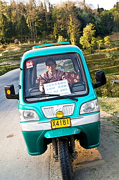 A funny looking taxi in the beautiful mountainous region of YuanYang in Yunnan,China
