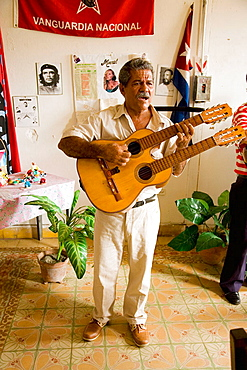 Musician livening up the working day in a sewing workshop, Baracoa, Guantanamo province, Cuba