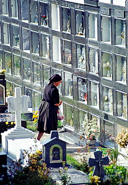 Old woman praying in cementery, Carnota, La Coruna province, Galicia, Spain