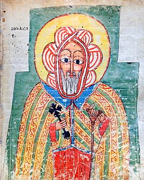 Ethiopia, Lalibela region, Church of Naakuto Lab, Priest holding the illuminated manuscript of The glory of king Naakuto Lab 15th century, Saint Abuna Aregawi