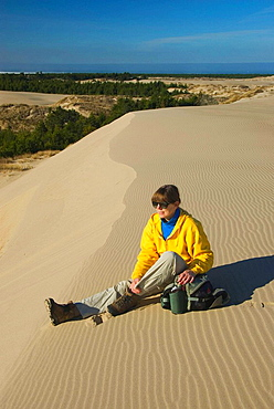 Hiker at Umpqua Dunes, Umpqua Dunes Scenic Area, Oregon Dunes National Recreation Area, Oregon, USA