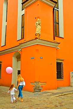 Mother and child walking in old town in central Poznan Poland EU