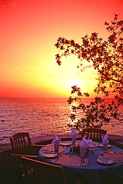 Jamaica, Negril, South Point, Xtabi Resort, table set for dinner at sunset