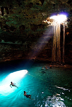 Mexico, Yucatan, Cenote Samula, near Valladolid, tourists enjoying a swim