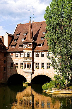 Germany Bavaria Nuremberg Heilig-Geist-Spital Old peoples residences above the River Pegnitz