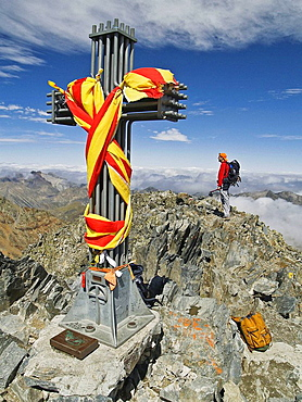 Mountaineer on the top of Pica dEstats, Pyrenees Mountains, Lleida province, Catalonia, Spain
