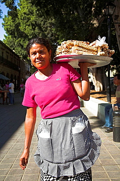 Woman carrying tray of confectionery, Zocalo, main town square, Oaxaca, Oaxaca State, Mexico