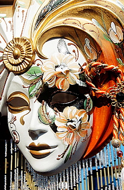 Colourful painted face mask for sale outside shop, Venice, Italy