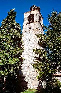 Holy Trinity Church, Sveta Troitsa Church, clock and bell tower through trees, Bansko, Bulgaria