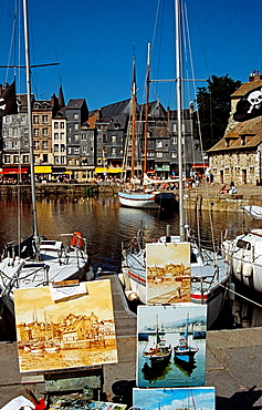 Paintings for sale on display on quayside, Honfleur, Normandy, France