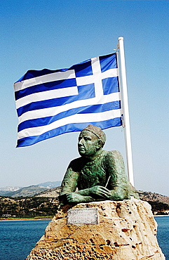 Statue with Greek flag above at entrance to Argostoli Port and Harbour, Argostoli, Kefalonia, Greece