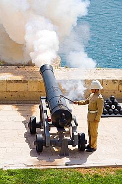 Firing of the noon day gun, at the Saluting Battery, Upper Barracca Gardens, Valletta, Malta