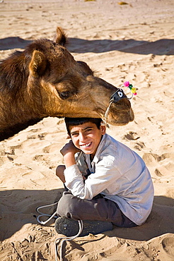 Camel and a young boy at Osian Camel Camp, Osian, Rajasthan, India