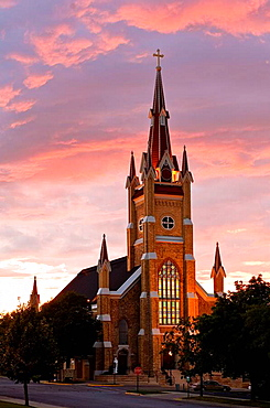 St  Marks Catholic Church in Shakopee, Minnesota at sunset  This German Gothic Church was built in 1865  The stained glass windows are from a family chapel of Emperor Franz Josef of Austria