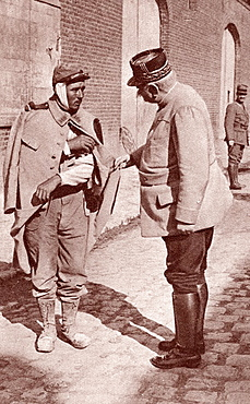 General Joffre sympathising with one of his wounded soldiers during World War I  Joseph Jacques Cesaire Joffre, 1852 to 1931  French general, Commander-in-Chief of the French Army  From The Illustrated War News 1915