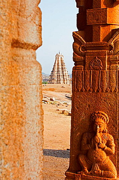 View of Virupaksha Temple between two columns, in Hampi India