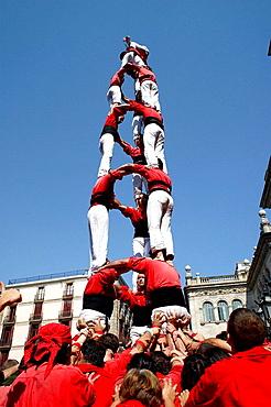 Castellers human towers builders in Placa de Sant Jaume, La Merce festival, Barcelona, Catalonia, Spain