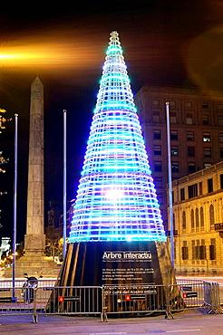 Low consumption Christmas tree in the corner between Avinguda Diagonal and Passeig de Gracia, Barcelona, Catalonia, Spain
