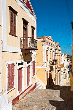 Nice houses along Kali Strata, the stairway to Chorio, Simi, Dodecanese islands, Greece