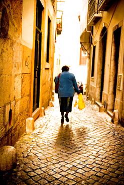 Woman in Alfama, Lisbon, Portugal