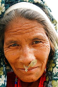 portrait of an older Tharu woman in Chitwan National Park in Nepal