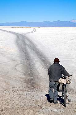 Man walking in a salt desert, Salinas Grandes, Jujuy province, North Argentina, South America