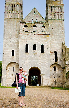 tourist in front of Abbey of Jumieges, Normandy, France