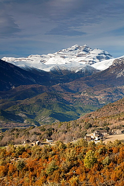 View of Las Tres Sorores peaks -Anisclo, Monte Perdido and Marbore- and San Lorien village, National Park of Ordesa and Monte Perdido, Huesca, Spain