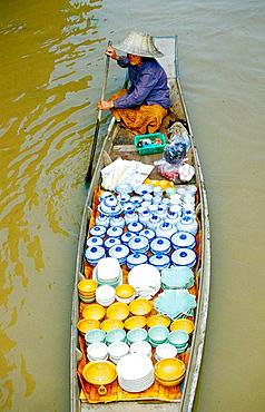 Porcelain seller on a small boat, Damnoek Saduak Floating Market, Bangkok, Thailand