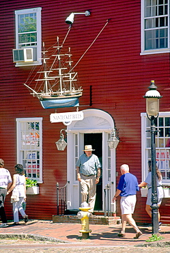 Nantucket town on Nantucket Island off Cape Cod, Massachusetts, USA Shop boutique on Main Street with model whaling boat