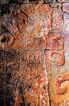 Toltec warrior carved on a stone wall at the ancient site of Chichen Itza, Yucatan, Mexico
