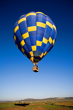 The balloon taking off a few feet above the ground on the plain of Antequera, Malaga, Andalusia, Spain