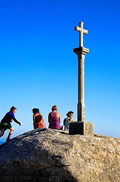 Pilgrims and Cruceiro Cross Cape Finisterre Finisterre Coruna province Spain Camino de Santiago
