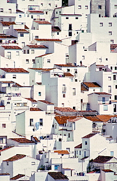Houses seem to tumble down a steep hillside as if imitating a cubist painting, in the village of Casares, on the edge of the Sierra de Bermeja near Estepona in Southern Spain