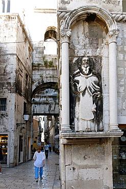 Statue on house facade by Iron Gate, Split, Croatia