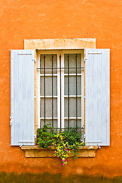Close up of blue window shutters with a flower box in Provence, France, Europe