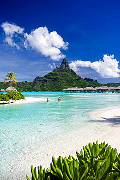 Tahiti, Society Islands, Bora Bora Island, Huts, the lagoon and Mount Pahia. Tahiti, Society Islands, Bora Bora Island, Huts, the lagoon and Mount Pahia
