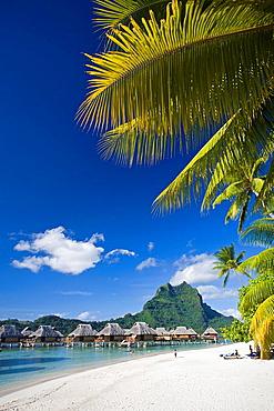 Tahiti, Society Islands, Bora Bora Island, Huts and mount Otemanu. Tahiti, Society Islands, Bora Bora Island, Huts and mount Otemanu