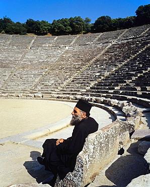 Pope Orthodox priest in antique theatre of Epidaurus, Peloponnese, Greece