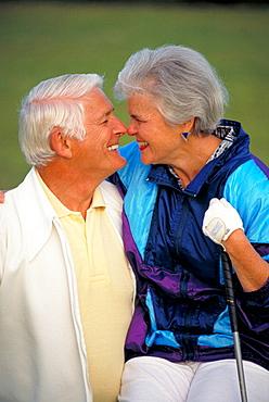 Senior couple golf