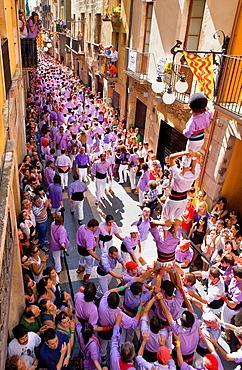 Colla Jove Xiquets de Tarragona 'Castellers' human tower walking, a Catalan tradition Festa de Santa Tecla, city festival Carrer Major Tarragona, Spain