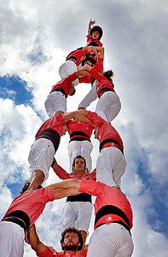 Colla Vella dels Xiquets de Valls 'Castellers' building human tower, a Catalan tradition Doctor Robert street La Bisbal del Penedes Tarragona province, Spain