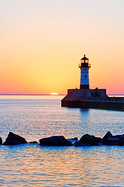 Sunrise at the north breakwater lighthouse at the entry to Duluth Harbor in Duluth, Minnesota