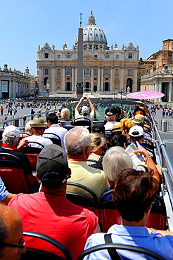 Tour bus views St Peter's Square and St Peter's Basilica Rome Italy Europe