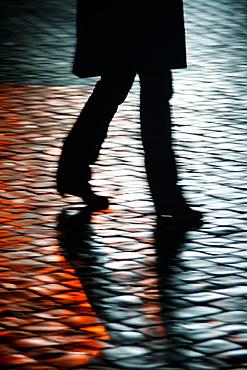 people walking in street at night