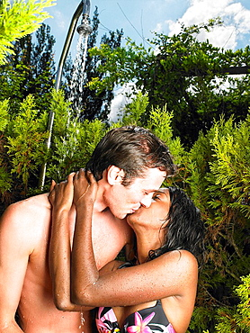Couple taking a shower, outdoors