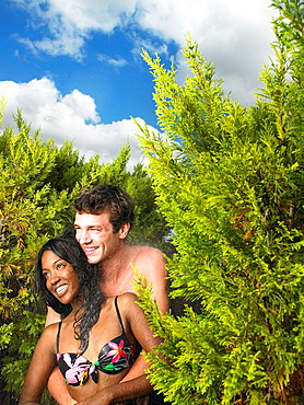 Couple in swimsuits, laughing
